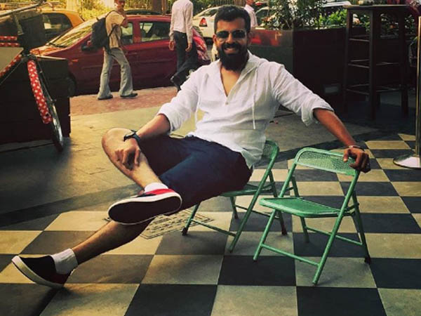 bejoy nambiar poses for a pic