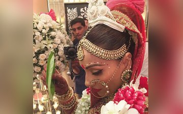 Check out the first pics of Bipasha as a bride