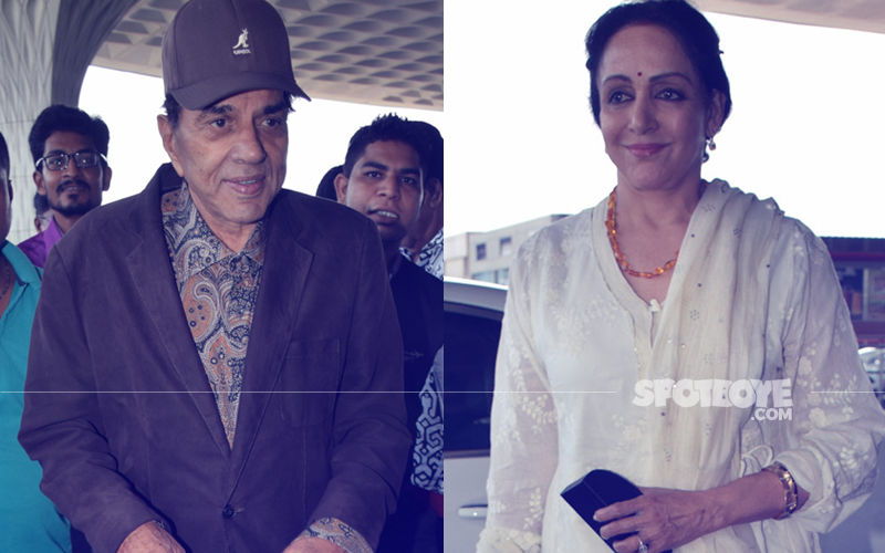 Airport Spotting: Dharmendra & Hema Malini Fly Out Of Mumbai