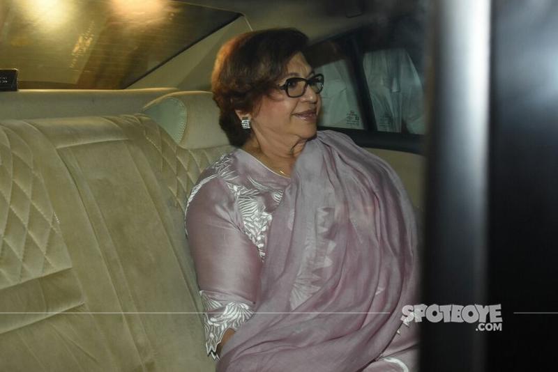 helen khan seated in a car