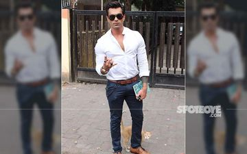 Karan Singh Grover AKA Mr Bajaj Gets Some Feline Love