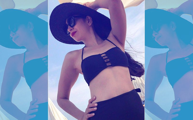 Fab Friday: Karisma Kapoor Looks Sexy In A Black Bikini
