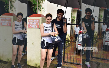 Doting Boyfriend Kartik Aaryan Holds An Umbrella For Ladylove Sara Ali Khan On A Rainy Thursday Morning