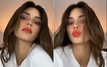 Kendall Jenner Does It Again; Blows Good Night Kisses From Big Red Kylie-Like Lips