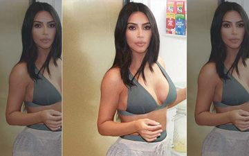 Kim Kardashian Models Plunge Bralette As She Gives Fans A Glimpse Into Her Giant Fridge