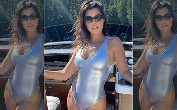 Kourtney Kardashian Flaunts Her Toned Midriff And Peachy Posterior In A Racy Bikini As She Goes For A Night Swim- PICS INSIDE
