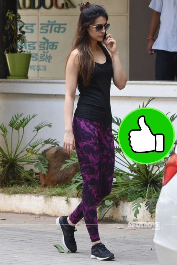 kriti sanon looks good in a black tube and purple yoga pants post a meeting with sushant singh rajput