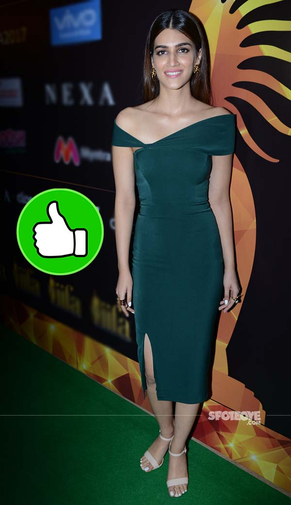 kriti sanon slays it in a green dress at the iifa 2017 press conference
