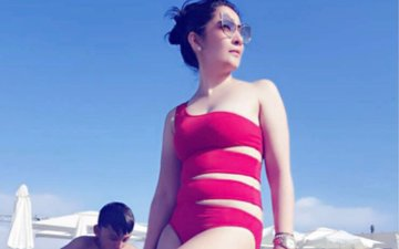 Maanayata Dutt Flaunts Her Sexy Figure In A Red Swimsuit
