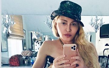 Madonna Leans On A Crutch As She Poses Topless For A Sizzling Selfie Months After Her Knee Surgery