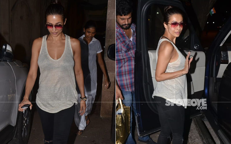Malaika Arora Channels Sexy Sophistication In A Sheer Top And Black Pants With Bosslady Boots