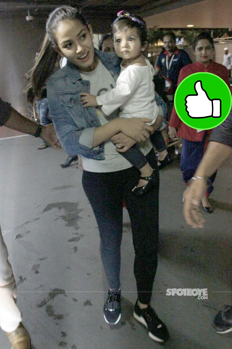 mira rajput spotted with baby misha at the airport