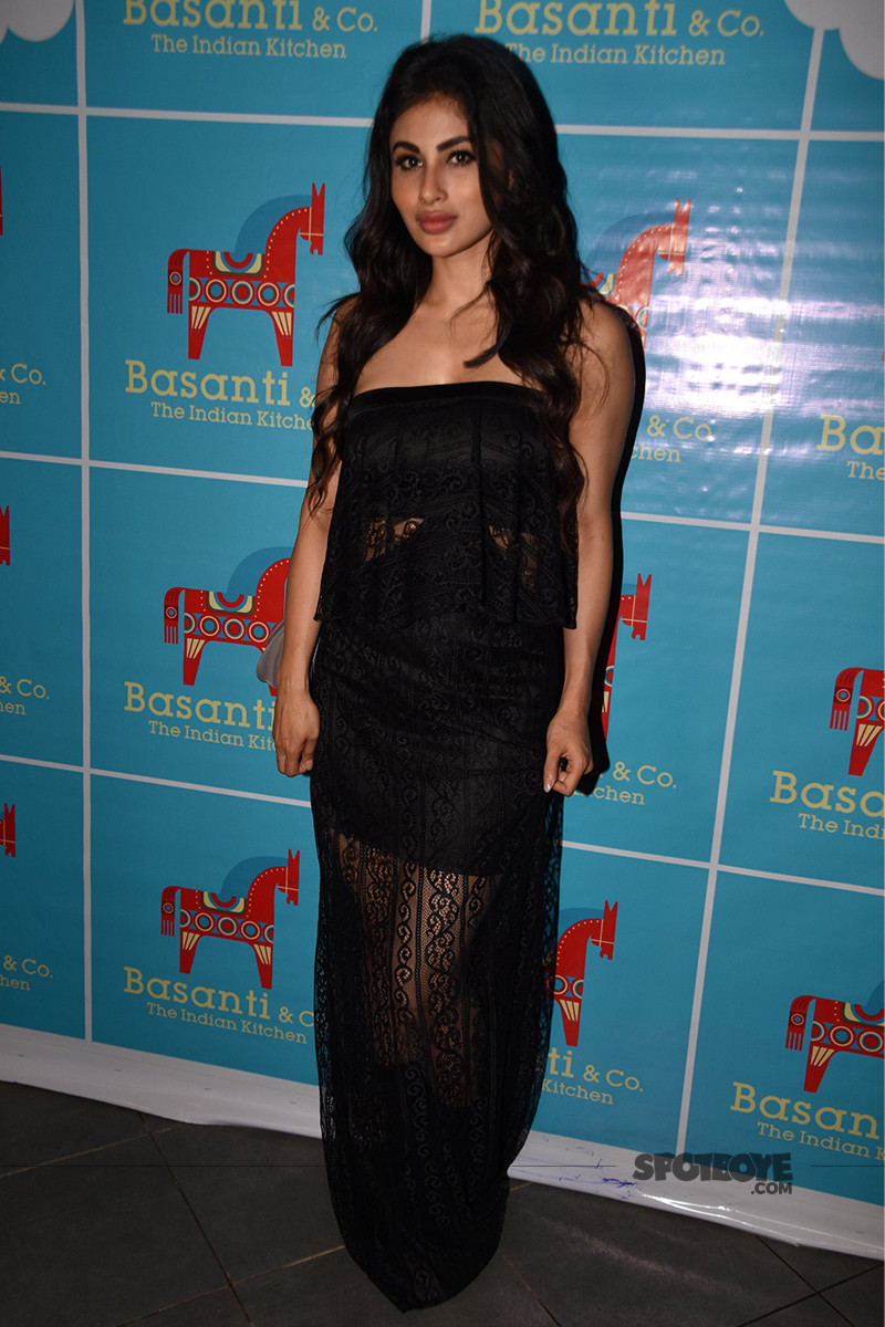 mouni roy is all smiles for the shutterbugs
