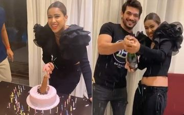 Nia Sharma Cuts A P*NIS Shaped Cake On Her Dirty 30 Birthday Party; Arjun Bijlani Pops Open A Bottle Of Champagne - Inside Pics And Videos