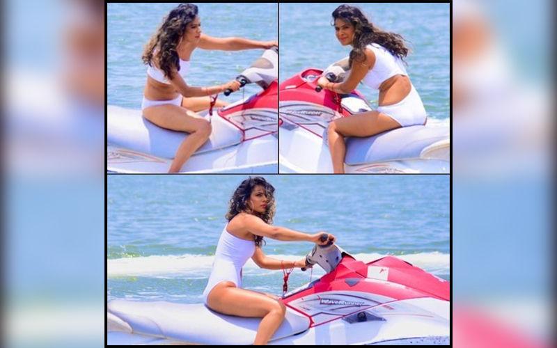 Nia Sharma Flirts With The Waves On A Water Scooter; Wears A Sexy White Peek-A-Boo Monokini For Jamai Raja's Digital Reboot