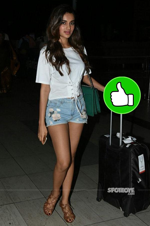 nidhhi agerwal in hot shorts at the airport