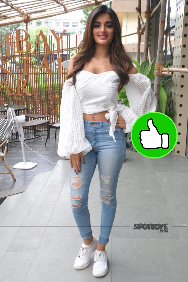 nidhhi agerwal keeps it simple with a white top and denim during munna michael promotions