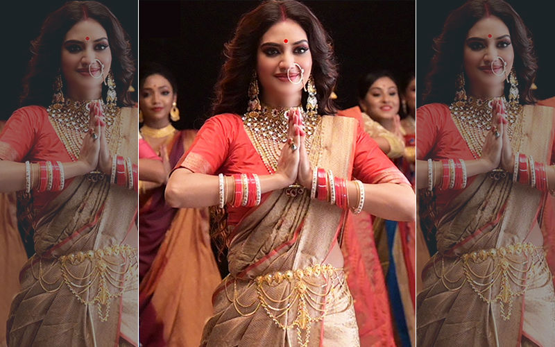 Nusrat Jahan Looks Like A Goddess In This Golden Coloured Saree, Shares Pic On Twitter