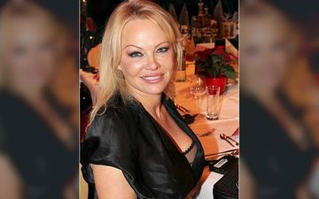 Pamela Anderson Recreates Her Iconic Baywatch Sexy Slow-Mo Beach Run In A Black Wetsuit – PICS