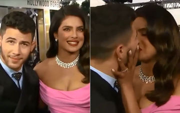 Priyanka Chopra And Nick Jonas Kiss On 'Kiss Cam'; Chopra Wipes The Red Hot Lipstick Off Jonas' Lips