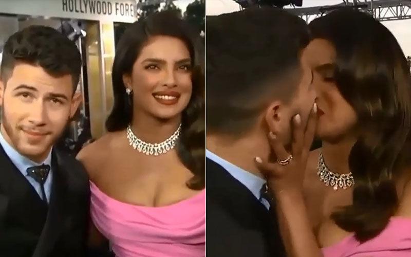 Priyanka Chopra And Nick Jonas Kiss On 'Kiss Cam'; Chopra Wipes The Red Hot Lipstick Off Jonas' Lips