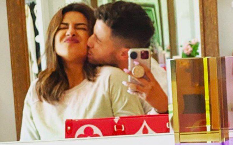 Priyanka Chopra Sits On Nick Jonas' Back As He Does Push Ups; Way Too Much Mush - Pic Inside