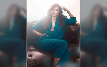 Pooja Sawant Flaunts Her Cleavage Wearing Nothing But A Blazer In This New Photoshoot