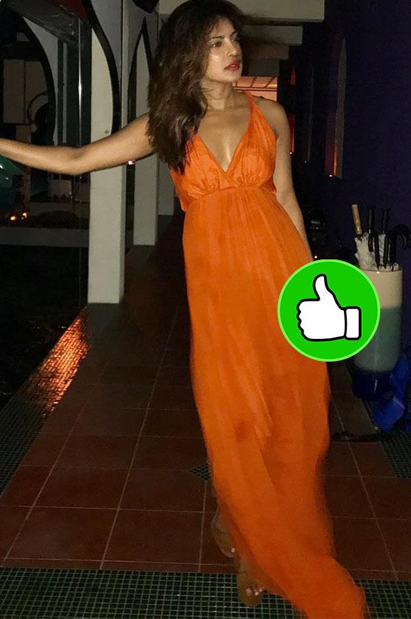 priyanka chopra looks stunning in an orange dress