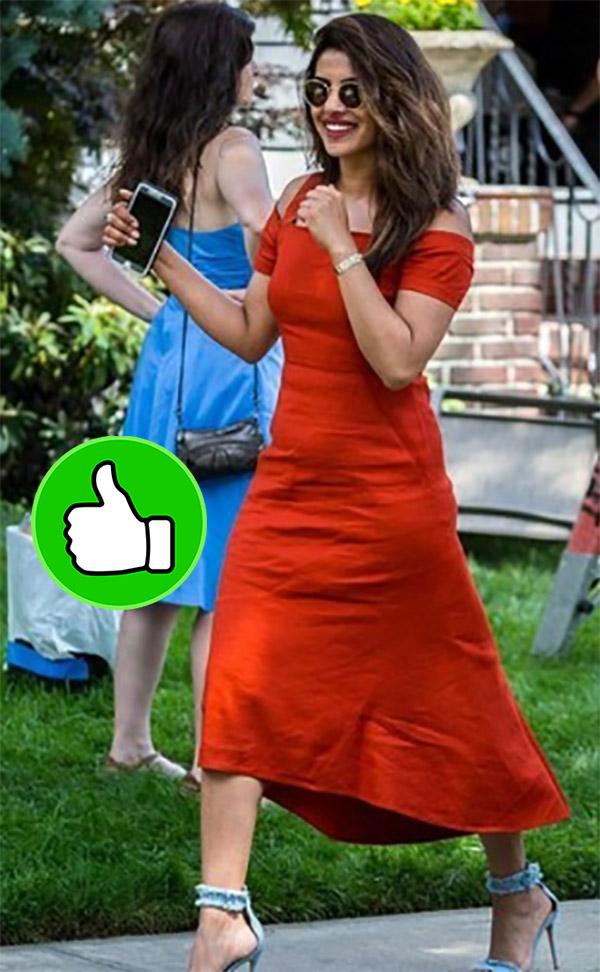 priyanka chopra wearing a pop orange colour fitted dress