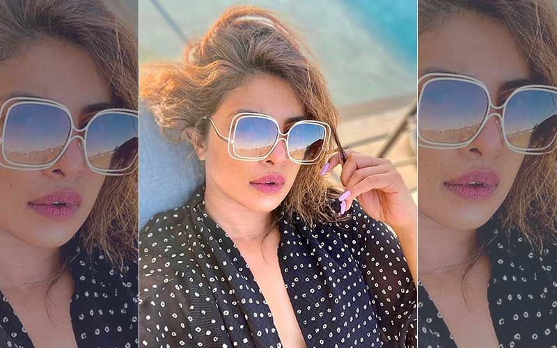 Priyanka Chopra's Pool Side Picture Will Make You Sweat; Looks Sassy In Oversized Sunglasses And Pink Nail Paint