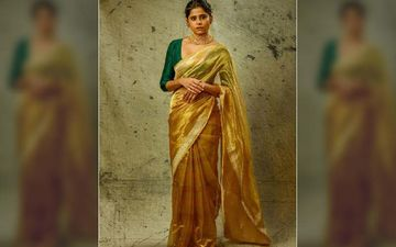 Sai Tamhankar Looks Like A Luscious Hot Beauty In A Golden Crepe Saree