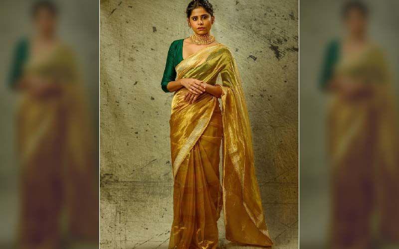 Sai Tamhankar Looks Like A Luscious Hot Beauty In A Golden Crepe Saree
