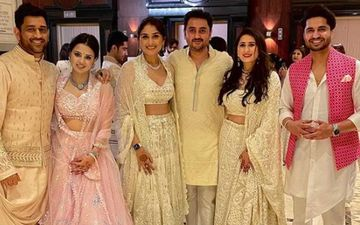 Sakshi Dhoni Stuns In A Pink Lehenga While MS Dhoni Complements Her In A Light Orange Sherwani At A Friend's Wedding