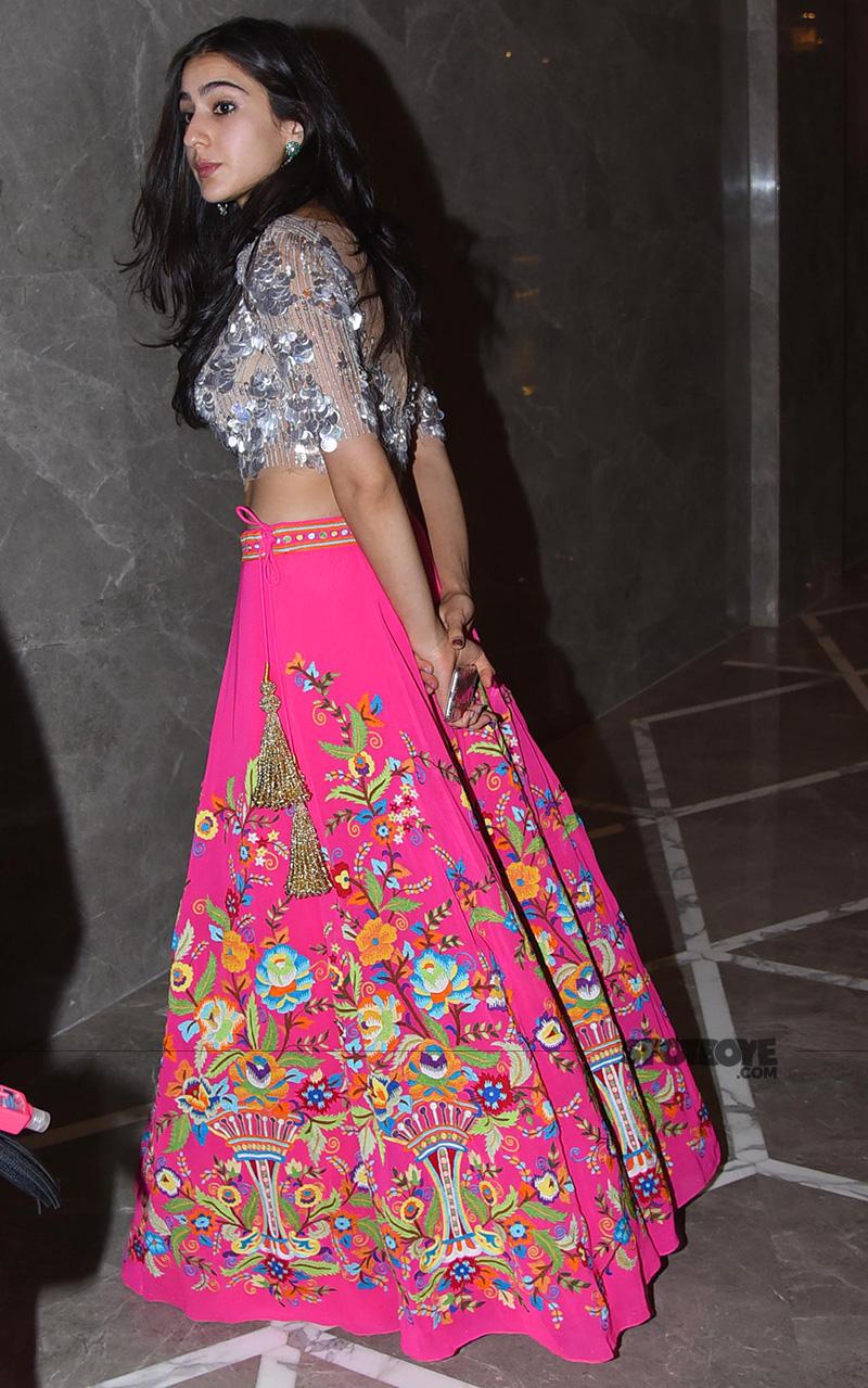 sara ali khan looks glamorous in a pink lehenga at abu jani sandeep khosla show