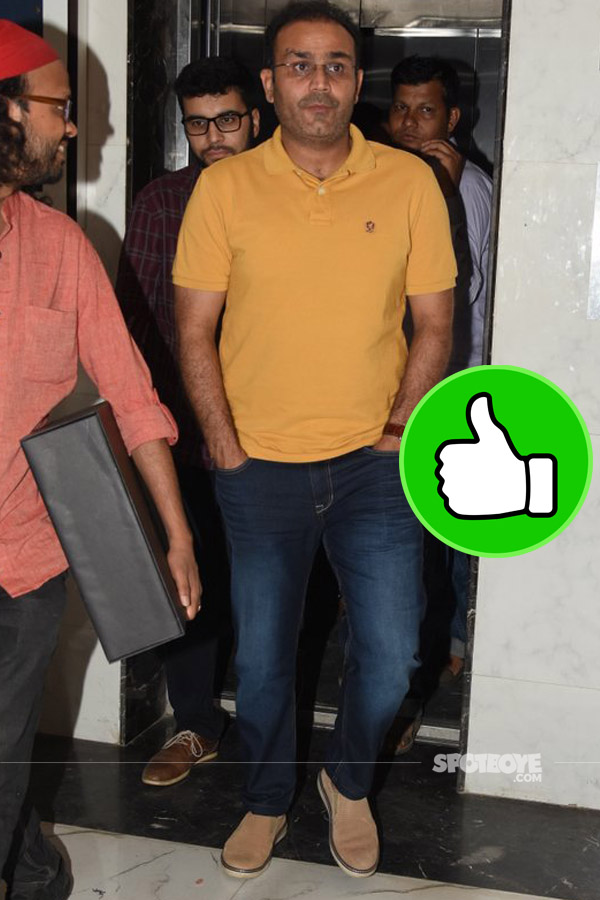 sehwag looks cool in jeans and a orange tee post a  meeting in bandra
