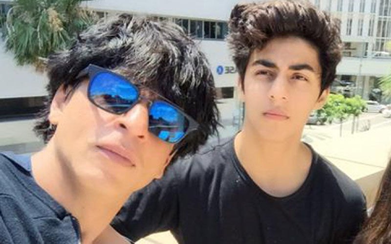 Shah Rukh Khan Hides His New Look From Paps With A Black Hoodie; Son Aryan Khan Makes Heads Turn In A Separate Outing-WATCH