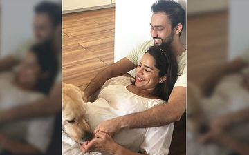 This Picture Of Pregnant Shikha Singh And Karan Shah Playing With Their Pet Looks Straight Out Of A Movie – See Pic