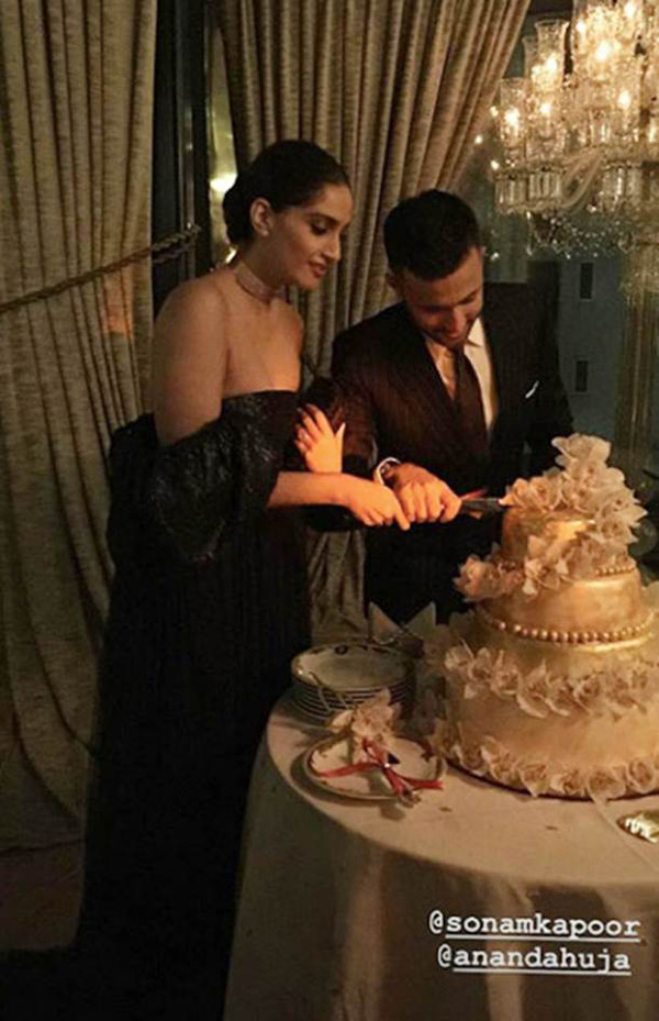 Sonam And Anand Cut A Cake