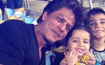 Cuteness Alert: Shah Rukh Khan Strikes A Pose With Dhoni's Daughter Ziva