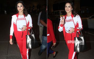 Sunny Leone Stands Out In A Red And White Sporty Look At The Airport