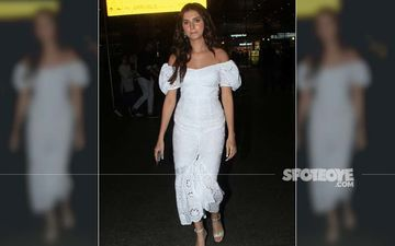 Tara Sutaria Makes The Airport Her Runway; Looks Ethereal In White Off-Shoulder Dress And Matching Heels
