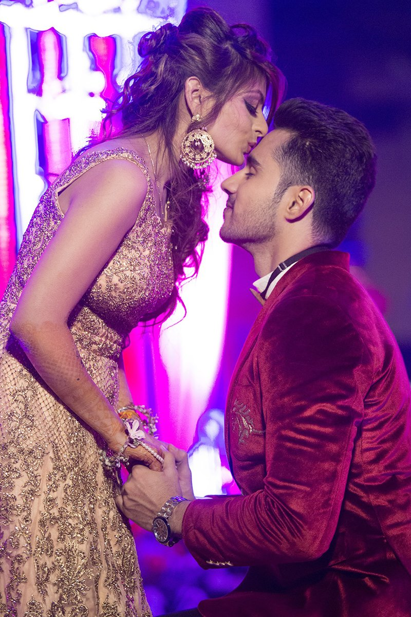 the bride akanksha jindal kisses her groom