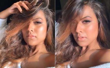 Naagin 4 Actress Nia Sharma Flaunts Her 'Bronzed Body, Bare Skin'; Looks Alluring Posing In A Bathrobe-WATCH Video