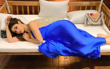Mouni Roy Is A Blue Satin Dress Striking A Sexy Pose Is Preparing Us For Hot Summers Already - PICS