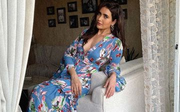 Khatron Ke Khiladi Winner Karishma Tanna Is A Sight To Behold In A Gorgeous Floral Dress With A Dramatic Plunging Neckline