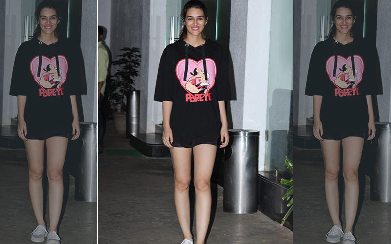 Kriti Sanon Goes For The College Girl Vibe In A Black Popeye Hoodie And Shortest Of Shorts