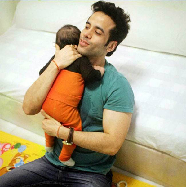 tusshar kapoor holding baby