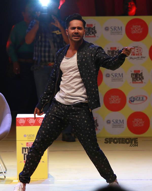 varun dhawan strikes a dancing pose
