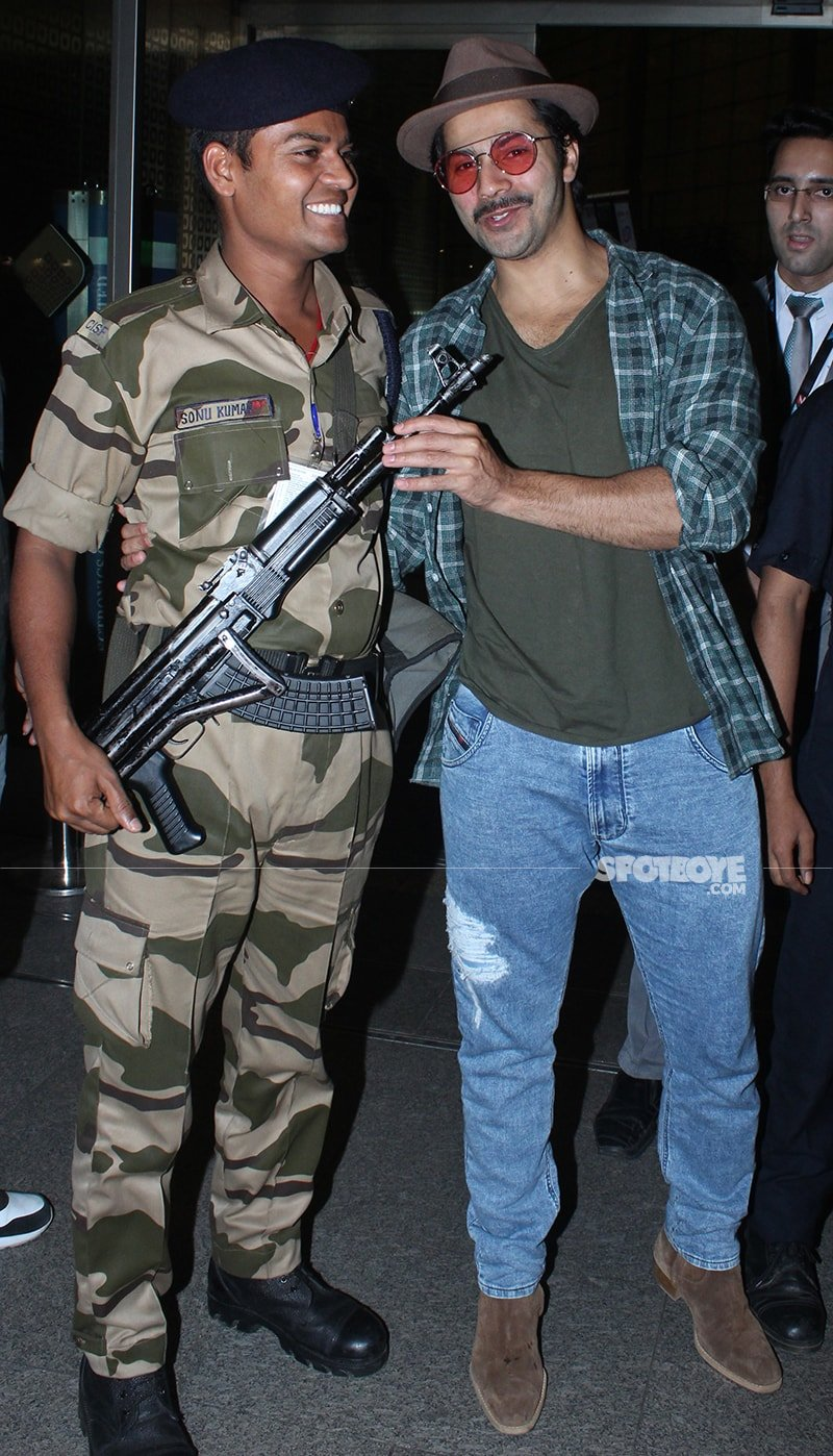 varun dhawan holding gun