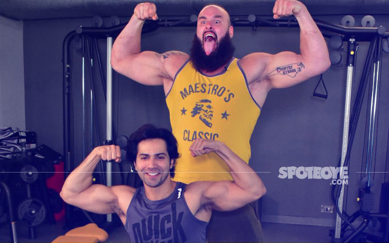 Varun Dhawan Gets Into A Flexing Contest With WWE Champ Braun Strowman